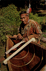 Martin Mitchell, Custodian of Village, with Hand Made Spruce Bark, Canoe.
