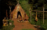 Birch Bark Wigwam and Lifelike Sculptures, in beautiful natural outdoor setting.